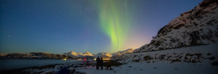 Two people admiring the Northern Lights