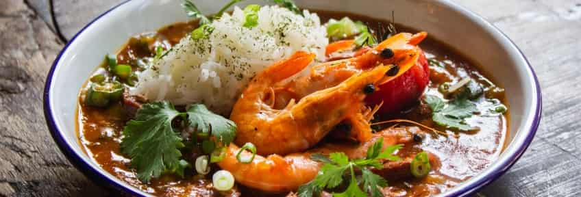 A plate of Gumbo with shrimps and rice